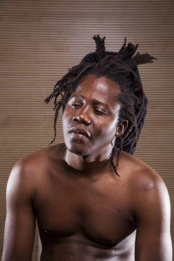 young rastafarian man enjoys rehearsing, portrait