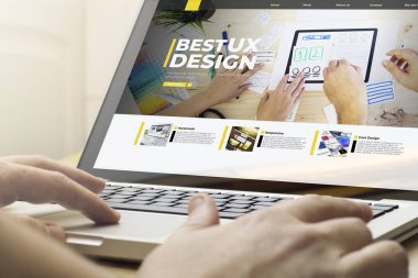 ux design concept: man using a laptop with ux design webstie on the screen. Screen graphics are made up.