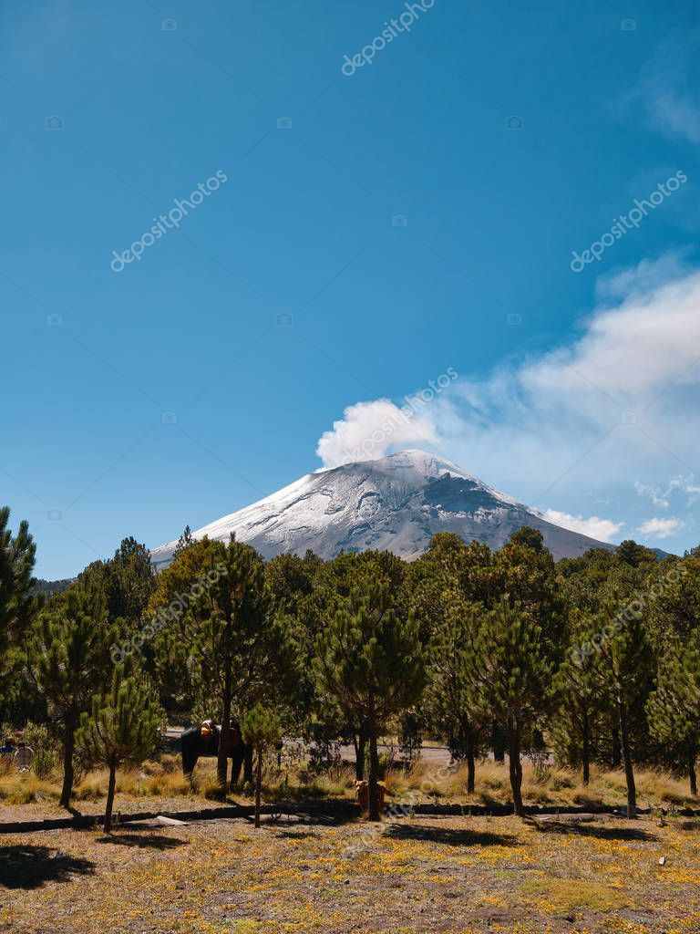 Popocatepetl volcano with fumarole comes out seen from Itza-Popo National Park, Mexico