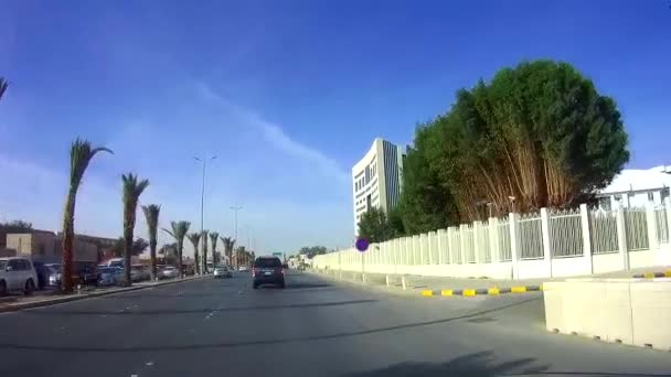 Driving on a sunny day in King Saud Road and passing Ministry of Education, Riyadh
