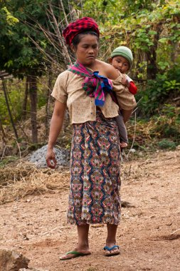 A young woman of the Shan people with a baby. Myanmar, December 2011.