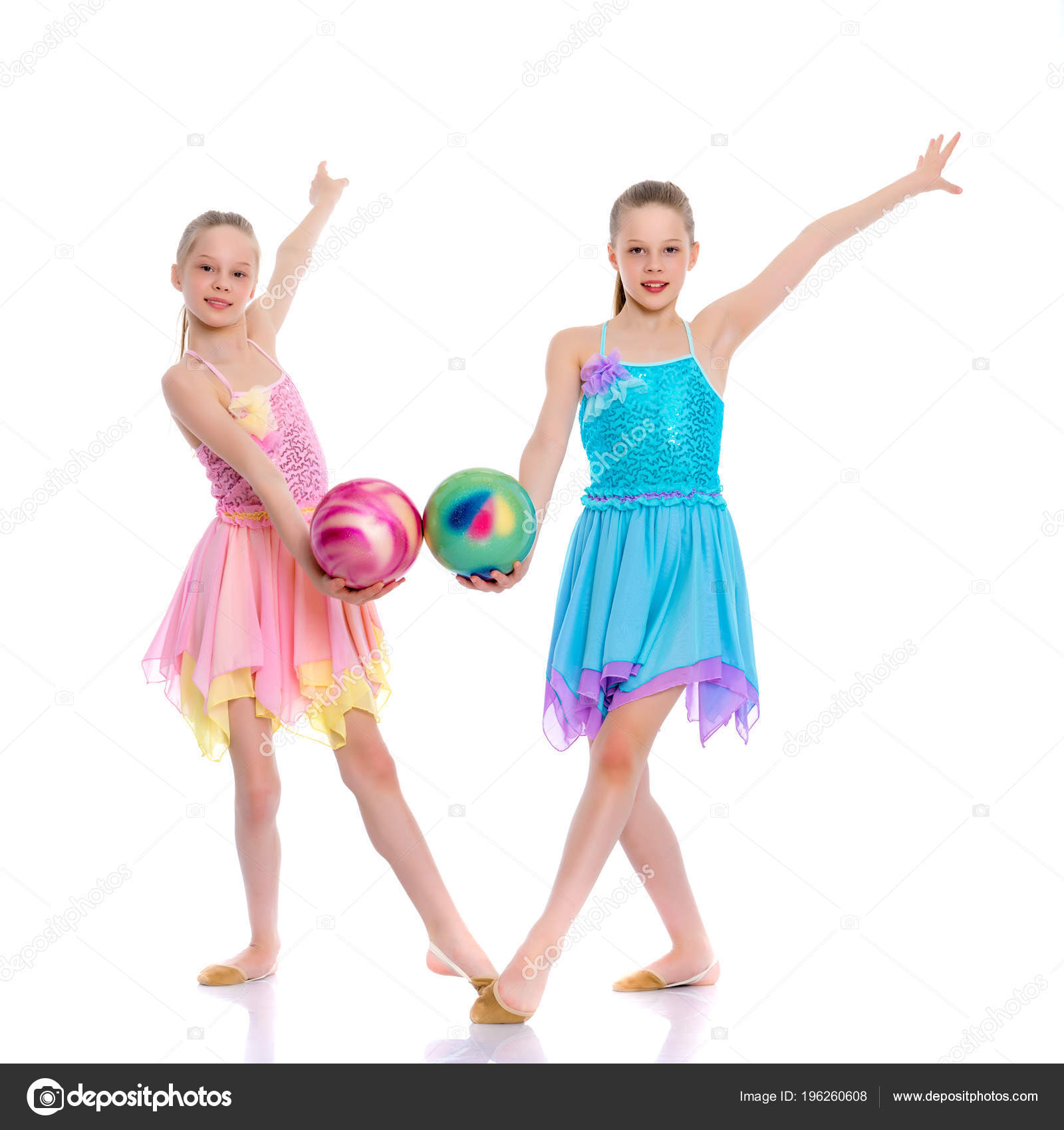 Girls gymnasts perform exercises with the ball  — Stock Photo
