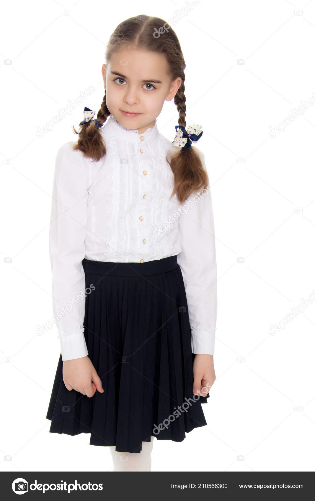 f5feac85e8 ... a white blouse and black long skirt, with neatly braided pigtails on  her head.She is standing right in front of the camera.Isolated on white  background.
