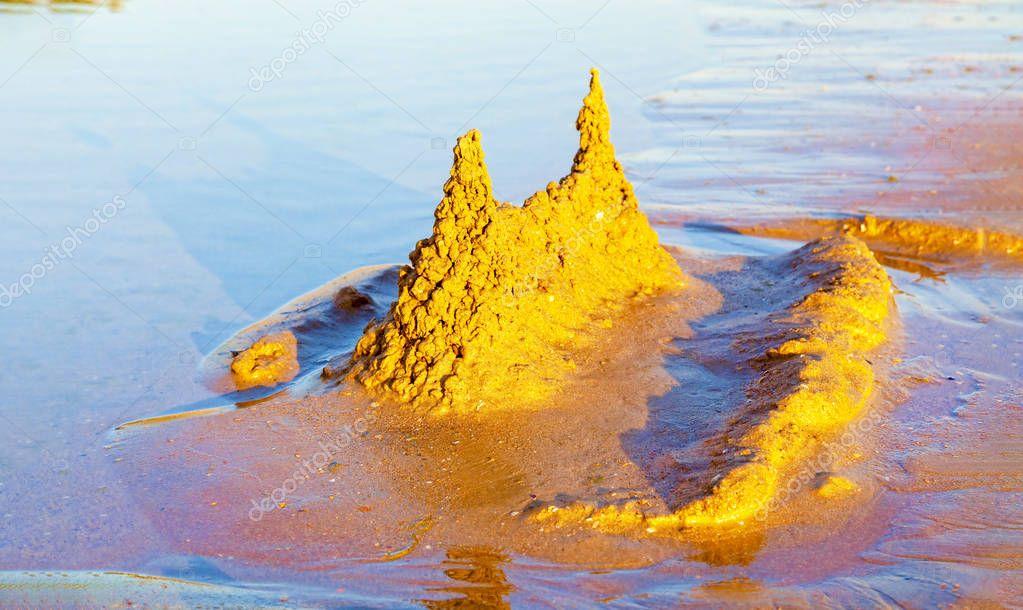 Sand castle on a tropical sea beach.