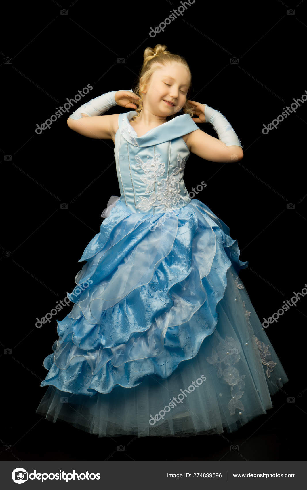 A Little Girl In A Long Elegant Dress Of A Princess On A Black Stock Photo C Lotosfoto1 274899596