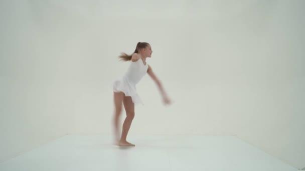 Graceful Girl Gymnast Performing Rhythmic Gymnastics Exercise.