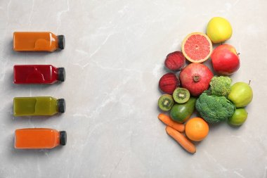 Flat lay composition with healthy detox smoothies and ingredients on light background