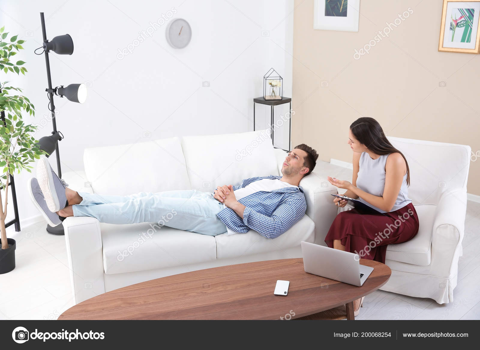 Depressed Young Man Having Appointment Psychologist Office Stock