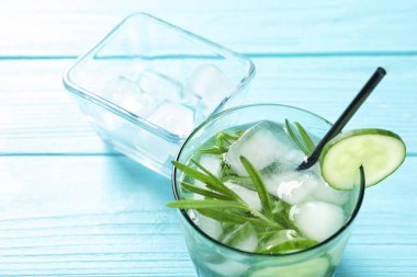Natural lemonade with cucumber in glass on table, closeup