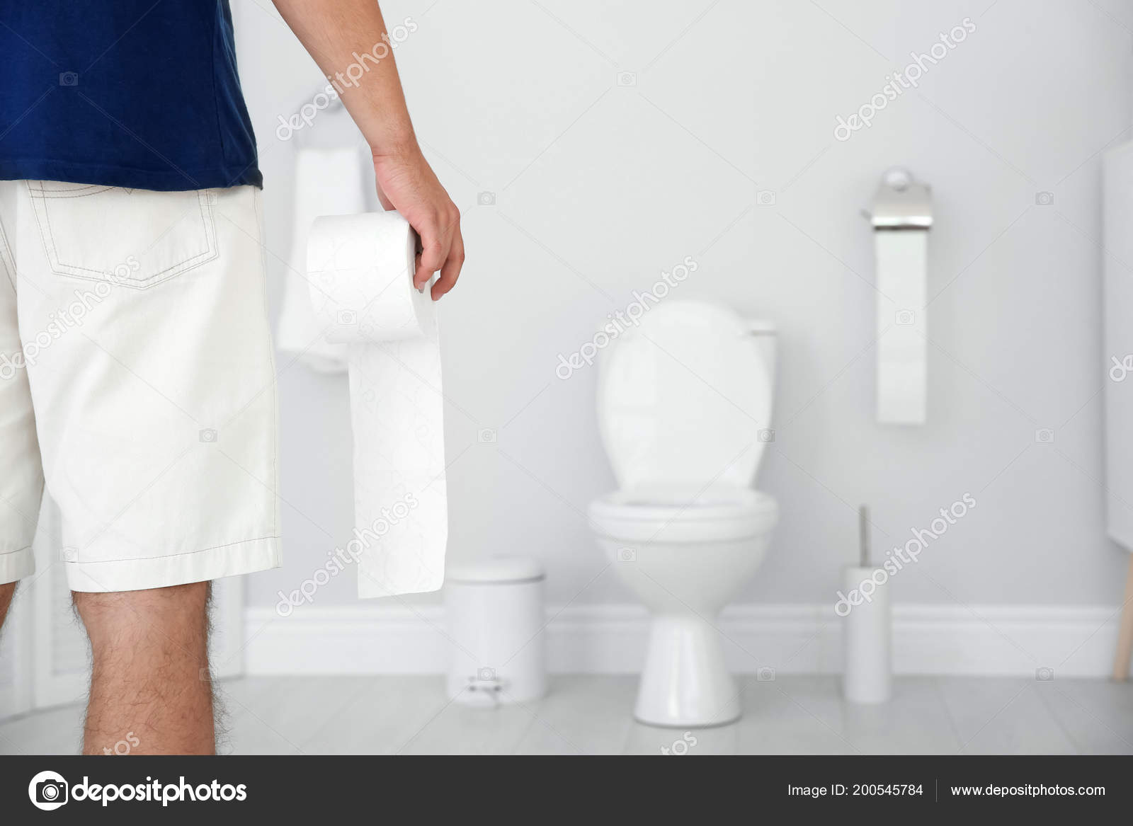 Pleasing Young Man Bath Tissue Standing Toilet Bowl Home Stock Creativecarmelina Interior Chair Design Creativecarmelinacom
