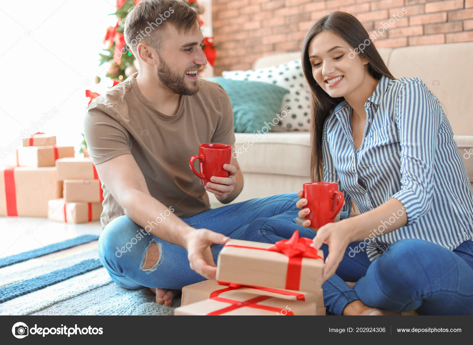 happy young couple christmas gifts home stock photo