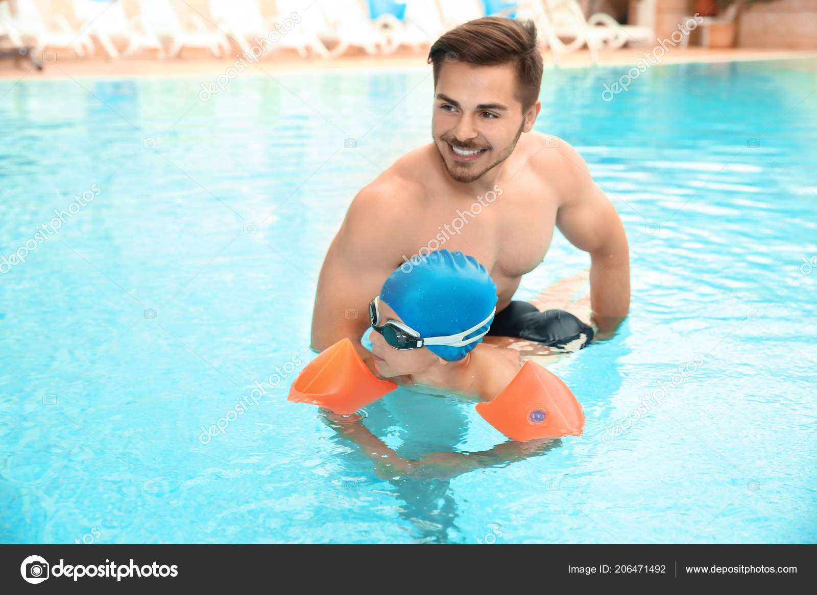 happy father teaching his son swim inflatable sleeves pool