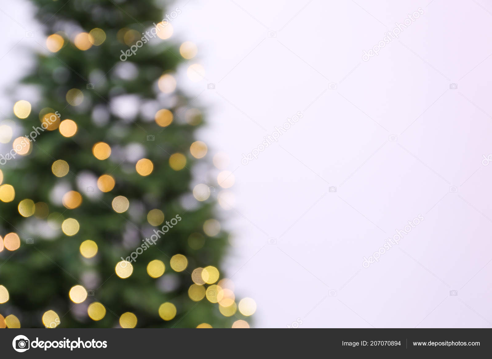 Christmas Tree White Background.Blurred View Beautiful Christmas Tree Fairy Lights White