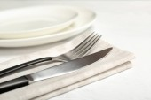 Fork and knife on table, closeup. New cutlery
