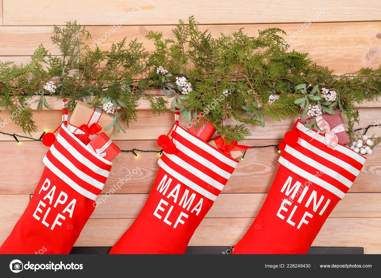 c2333c4d8aa Christmas stockings hanging on wooden wall. Festive interior — Photo by  liudmilachernetska gmail.com