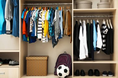 Large wardrobe with teenager clothes, shoes and accessories
