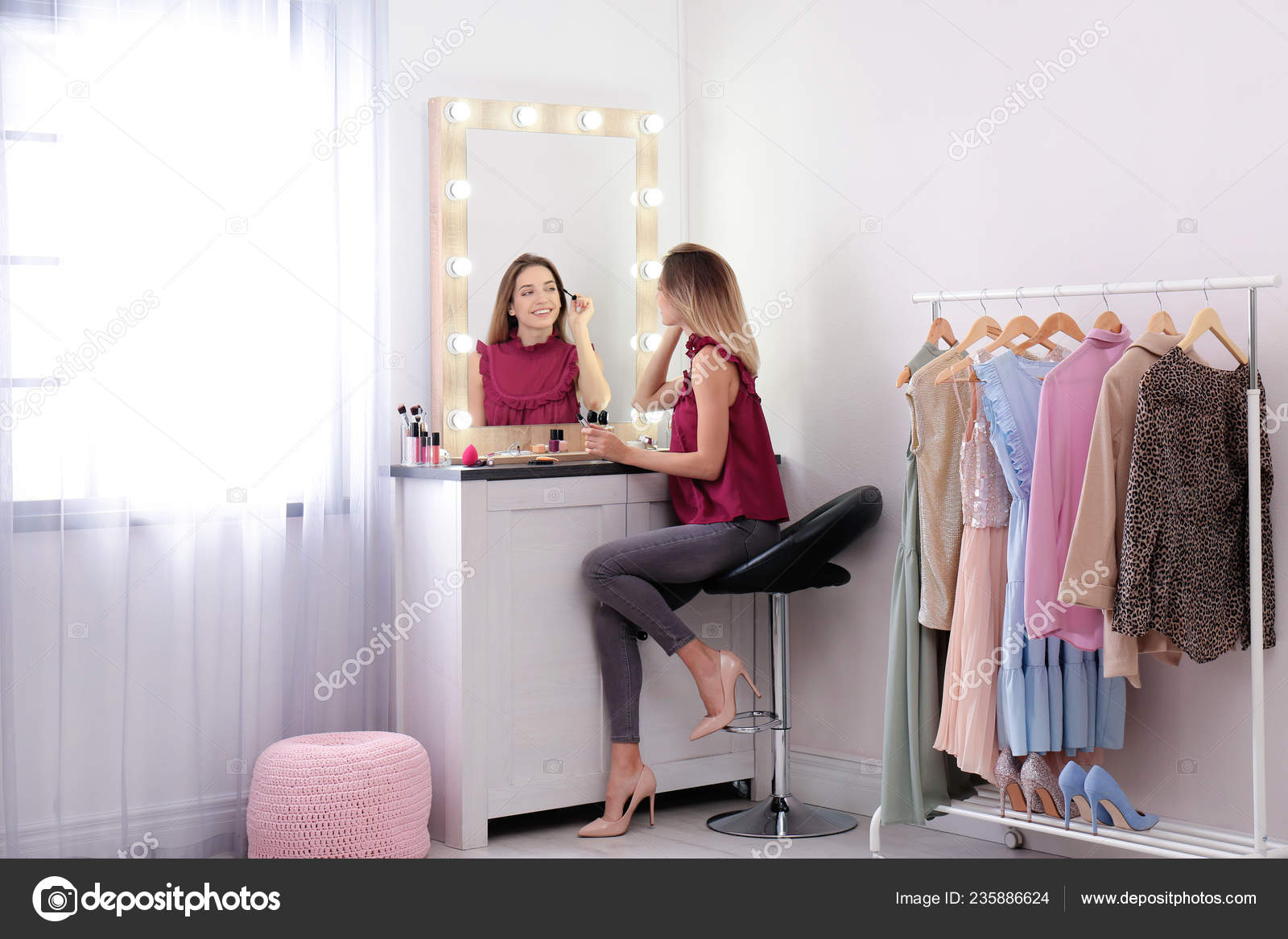 Woman Applying Makeup Mirror Light Bulbs Dressing Room