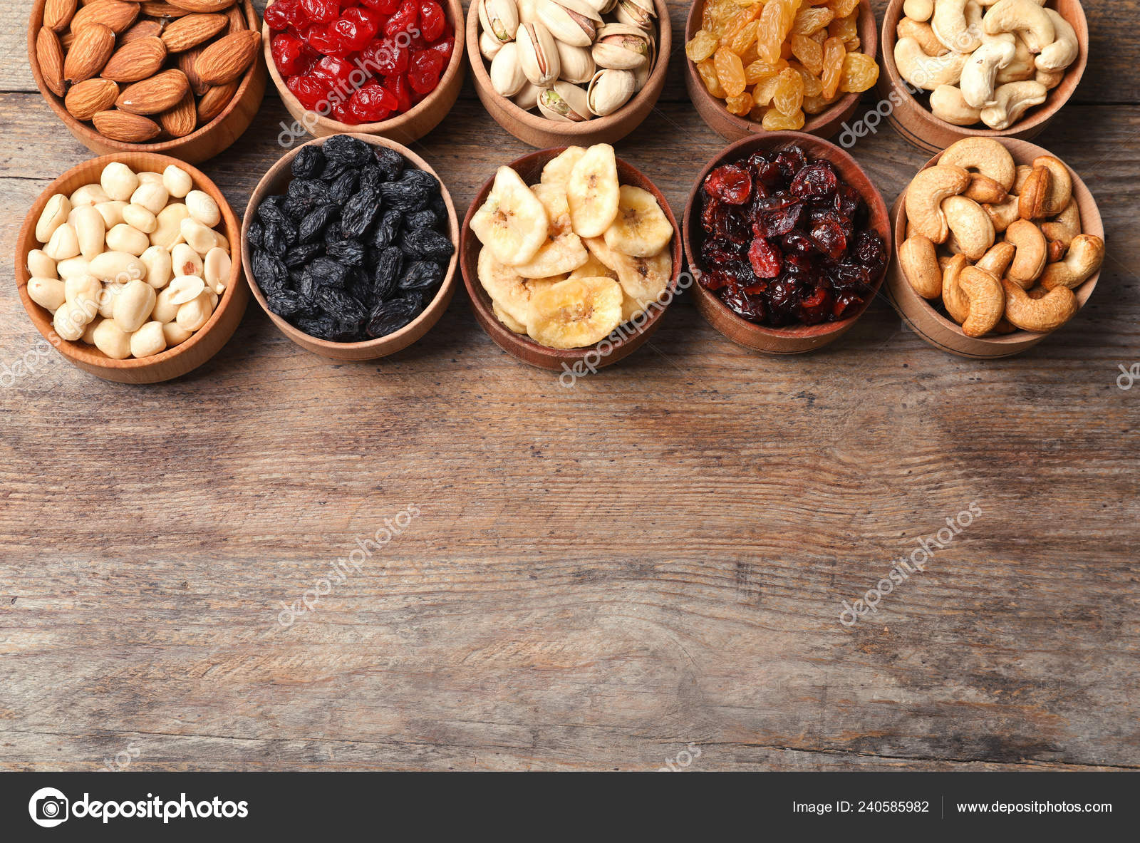 Composition Different Dried Fruits Nuts Wooden Background