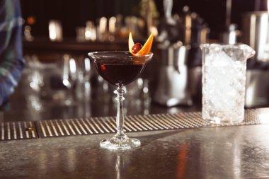 Fresh alcoholic Manhattan cocktail on bar counter