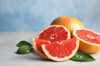 Fresh tasty grapefruits on table. Space for text