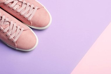 Bright stylish shoes on color background, top view. Space for text