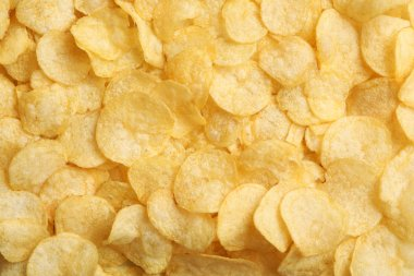 Crispy potato chips as background, top view