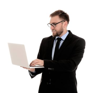 Happy young businessman using laptop on white background