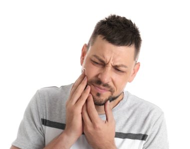 Man suffering from toothache on white background