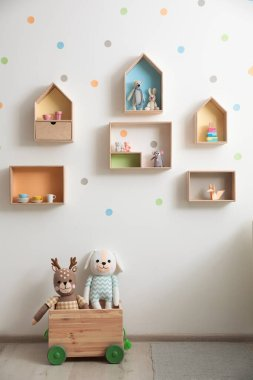 Stylish baby room interior design with house shaped shelves