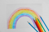 Painting of rainbow and pencils on white background, flat lay. Stay at home concept
