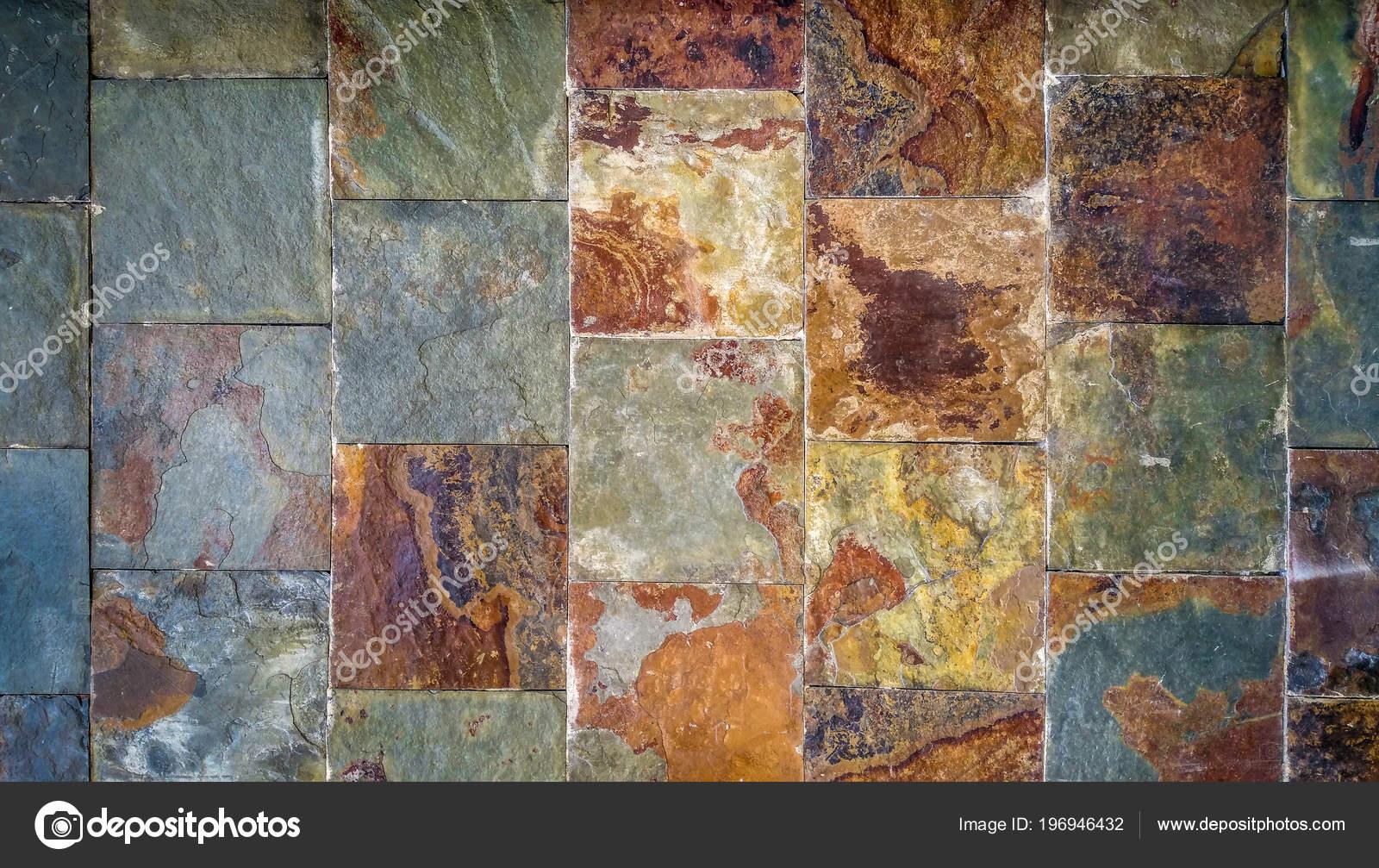 Vecchio fondo del muro costituito piastrelle color ruggine stile