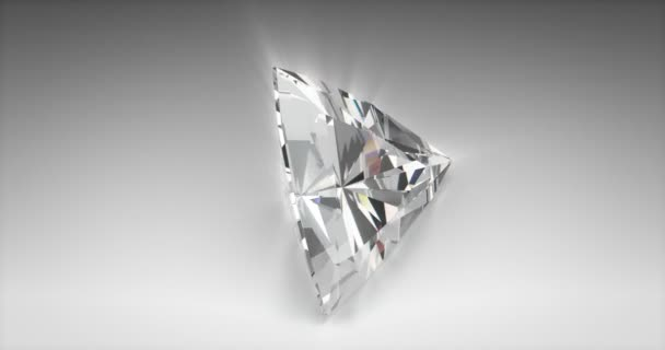 Trilliant cut diamond on gray background (seamless)
