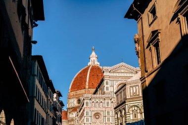historic buildings and famous Basilica di Santa Maria del Fiore in Florence, Italy