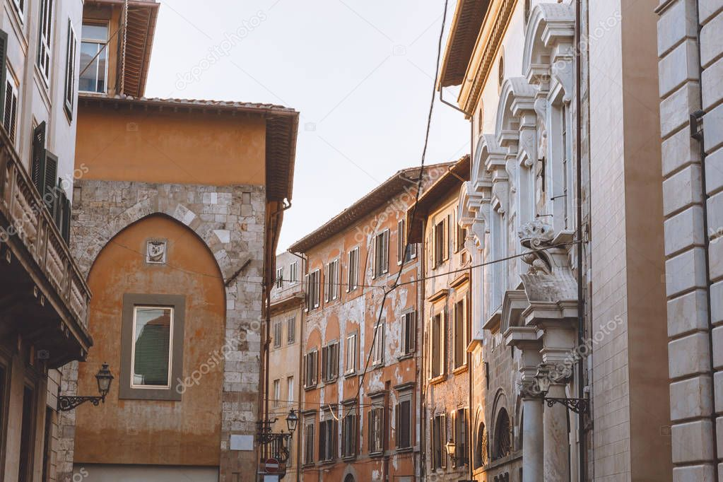 old city street with ancient houses, Pisa, Italy