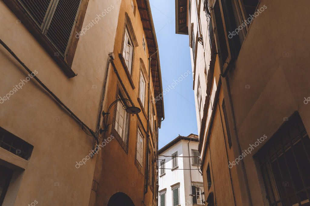 narrow street in old city, Pisa, Italy