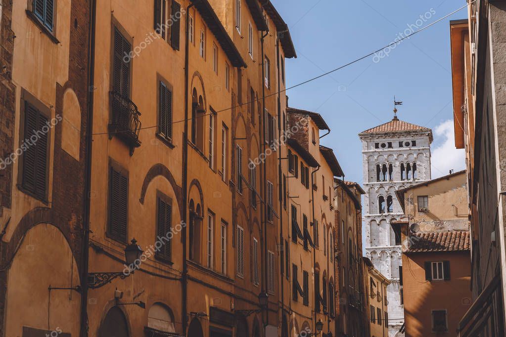 old street with ancient buildings in Pisa, Italy