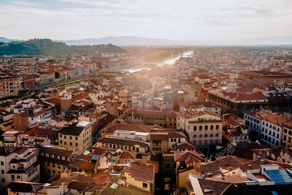 FLORENCE, ITALY - JULY 17, 2017: aerial view of beautiful cityscape with historic buildings and rooftops in florence, italy
