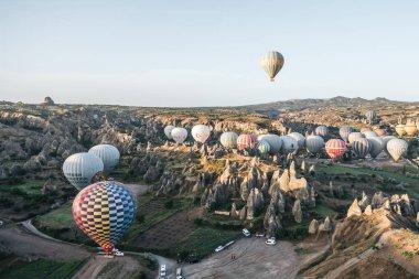 CAPPADOCIA, TURKEY - 09 MAY, 2018: hot air balloons flying above beautiful bizarre rock formations in cappadocia, turkey stock vector