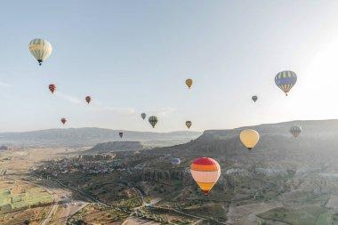 CAPPADOCIA, TURKEY - 09 MAY, 2018: beautiful colorful hot air balloons flying above cappadocia, turkey stock vector