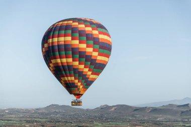 Colorful hot air balloon flying in sky above cappadocia, turkey stock vector