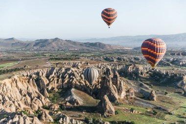 Hot air balloons flying above majestic goreme national park, cappadocia, turkey stock vector