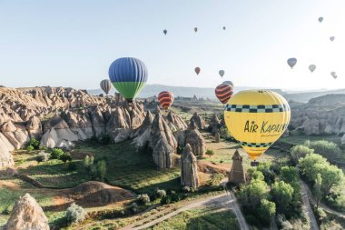 CAPPADOCIA, TURKEY - 09 MAY, 2018: colorful hot air balloons flying in sky above famous goreme national park, cappadocia, turkey stock vector