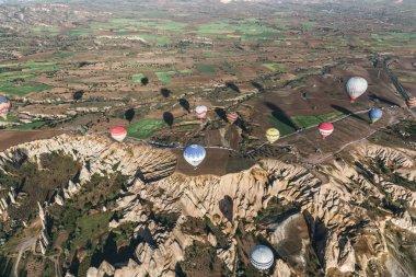 CAPPADOCIA, TURKEY - 09 MAY, 2018: aerial view of various colorful hot air balloons flying above cappadocia, turkey