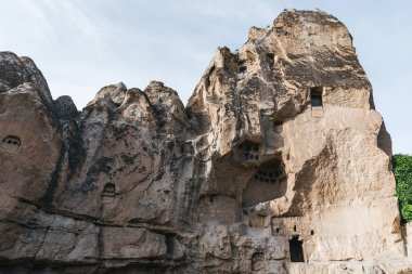 low angle view of beautiful rocks with caves in goreme national park, cappadocia, turkey