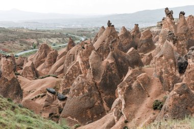 aerial view of beautiful eroded rock formations at cloudy day, cappadocia, turkey