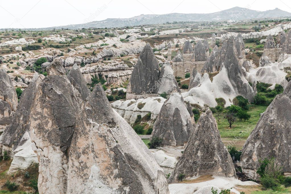majestic landscape with bizarre rock formations in goreme national park, cappadocia, turkey