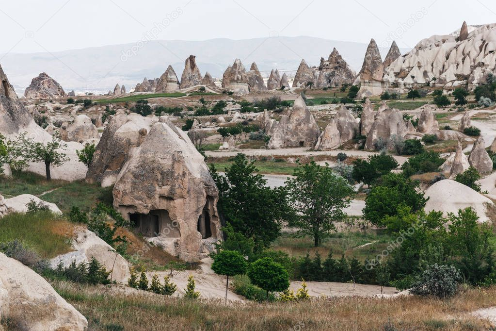scenic tranquil view of famous rock formations and caves in cappadocia, turkey