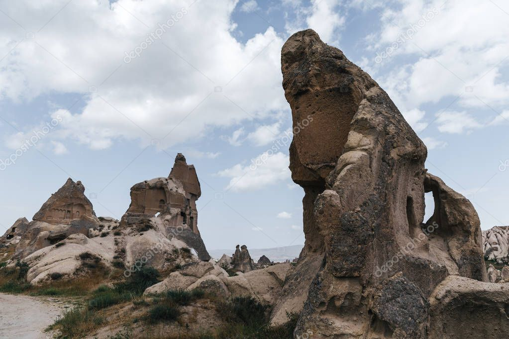low angle view of bizarre rocks in goreme national park, cappadocia, turkey