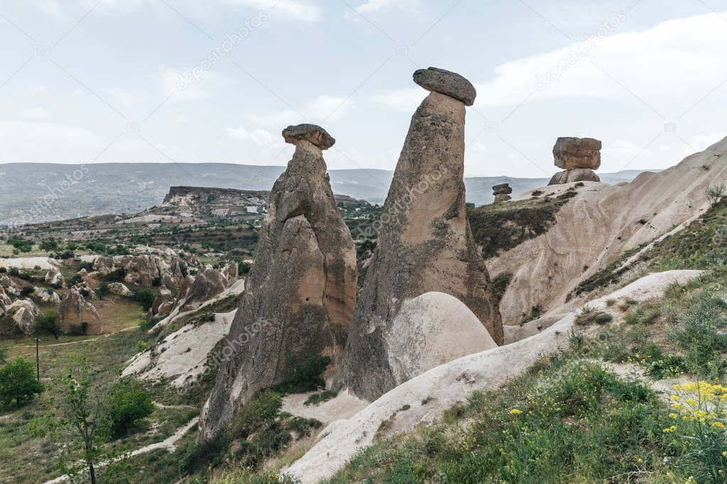 majestic landscape with eroded bizarre rock formations in famous cappadocia, turkey