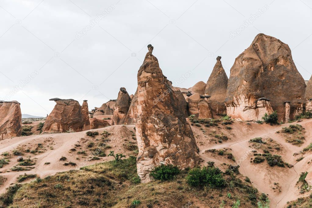 scenic landscape with eroded bizarre rock formations in famous cappadocia, turkey
